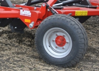 Support wheels for precision working depth control.